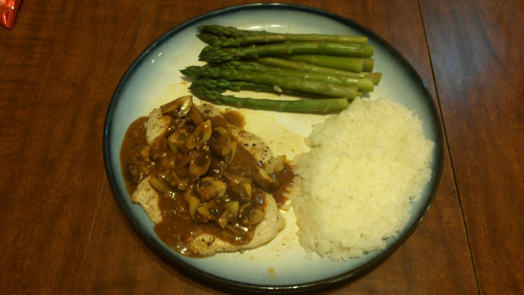 Pork in a thickened beer reduction with mushrooms, with asparagus and rice.